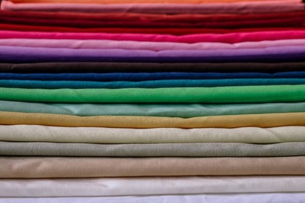 different colors of linen stacked on top of eachother
